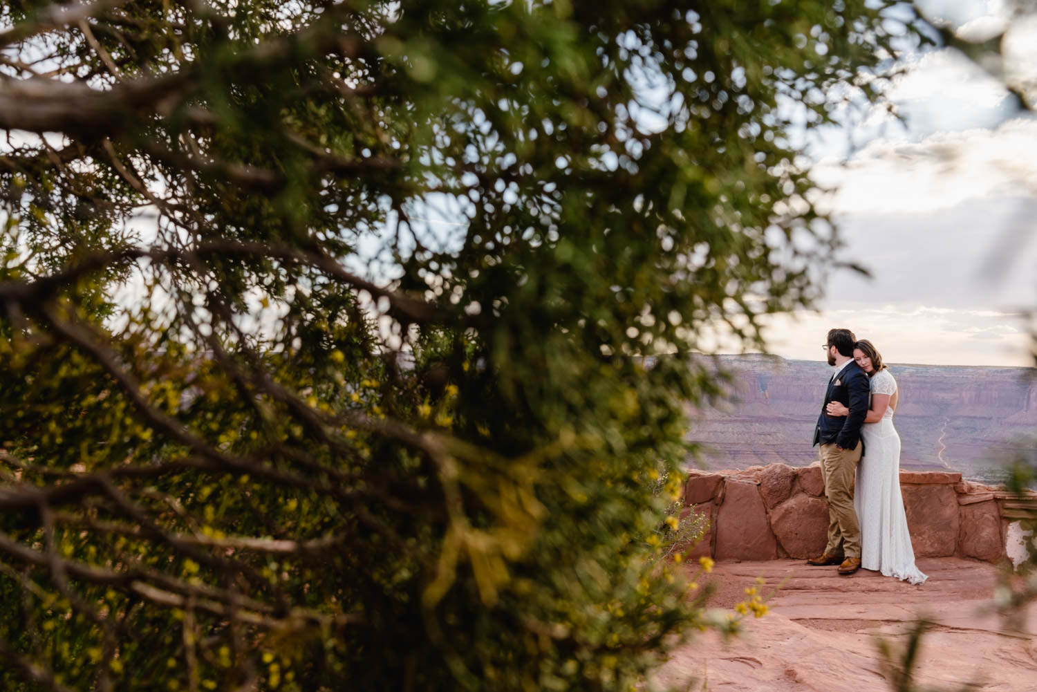 Dead Horse Point elopement bride hugging groom photo