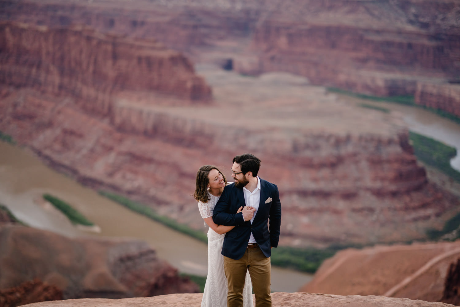 Dead Horse Point elopement couple hugging over Colorado River photo