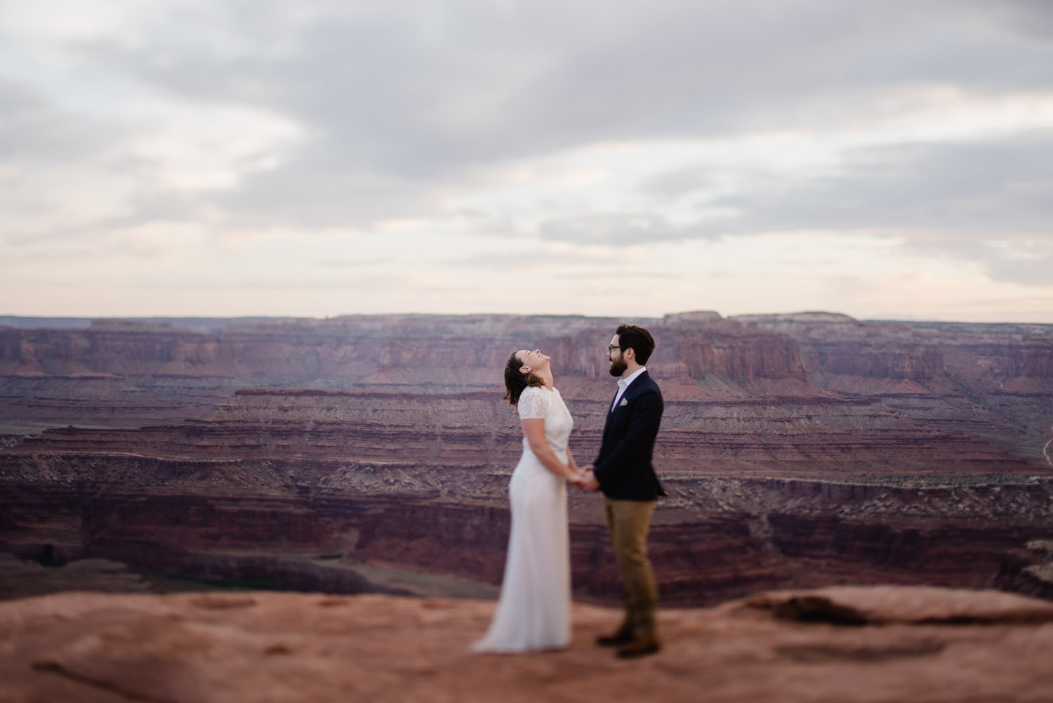 Dead Horse Point elopement bride with head back laughing photo