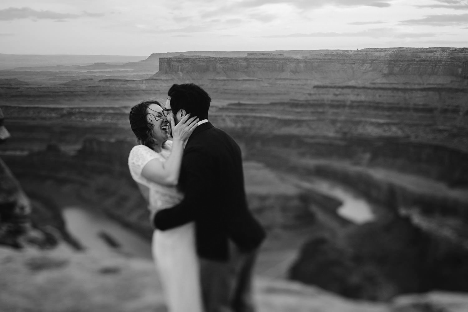 Dead Horse Point elopement black and white couple laughing photo