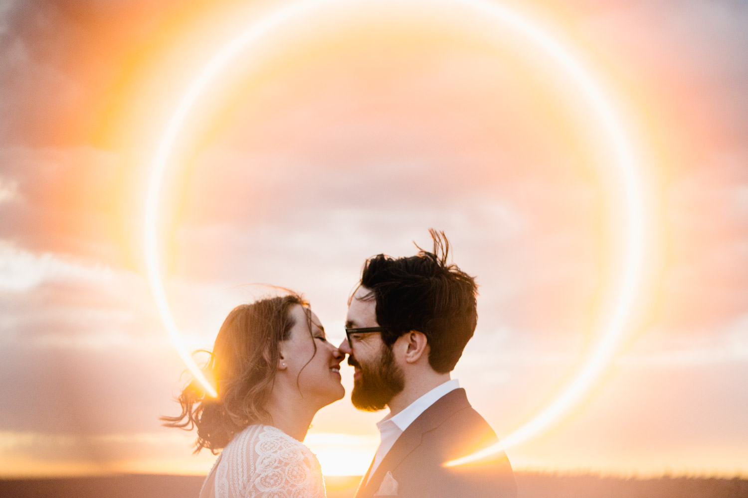 Dead Horse Point elopement kiss with ring of fire photo