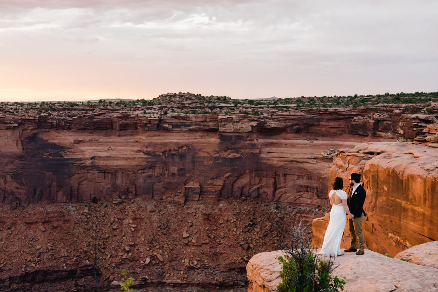 Dead Horse Point elopement golden hour landscape with bride and groom photo