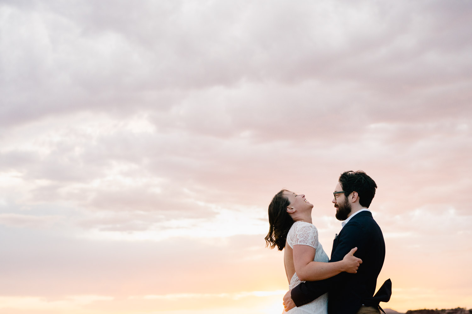 Dead Horse Point elopement couple laughing in sunset photo