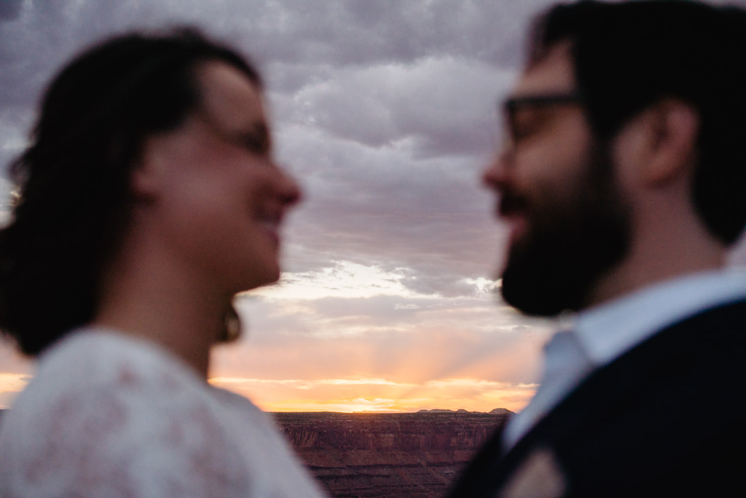 Dead Horse Point elopement bride and groom with sunset photo