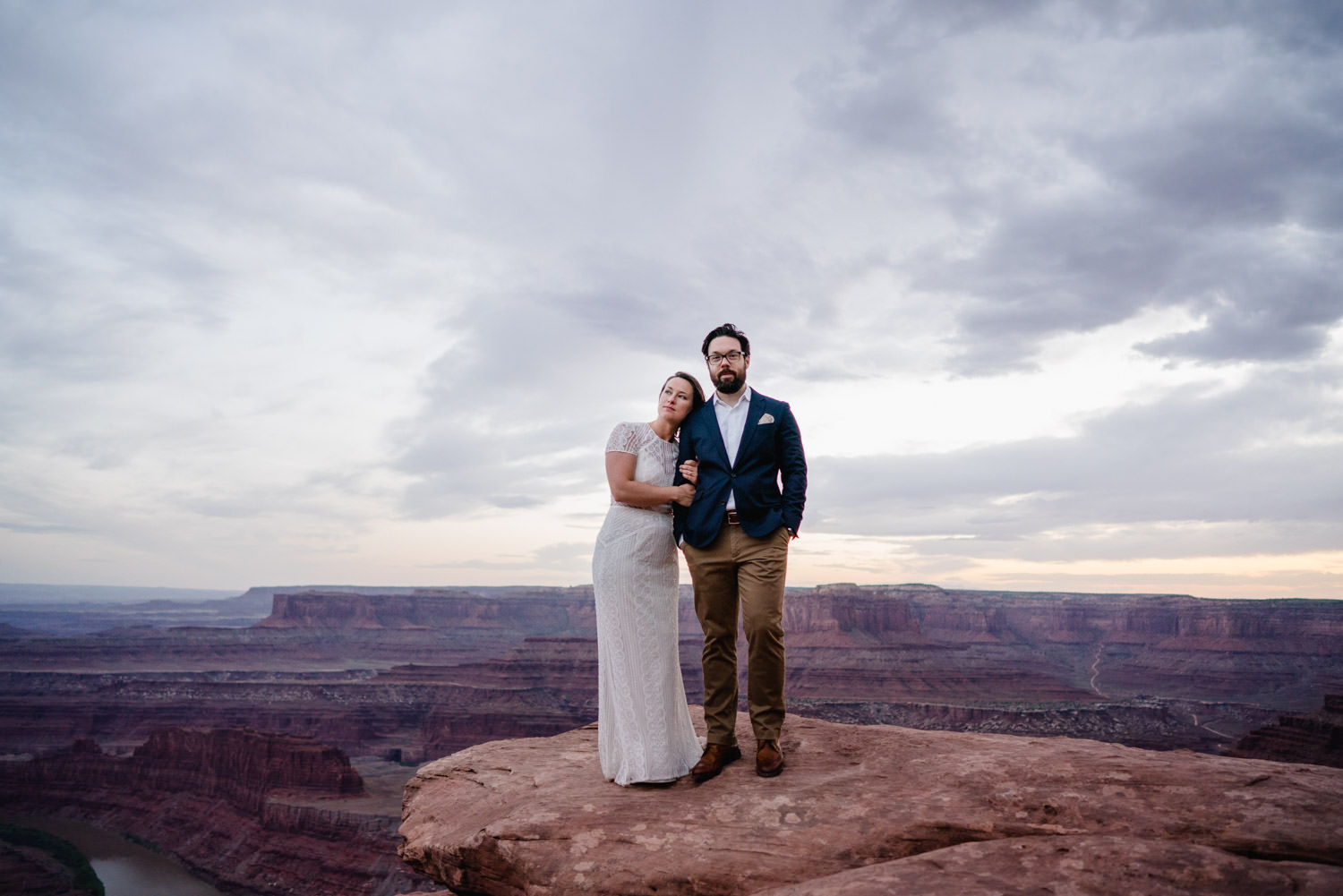Dead Horse Point elopement portrait on rock perch photo