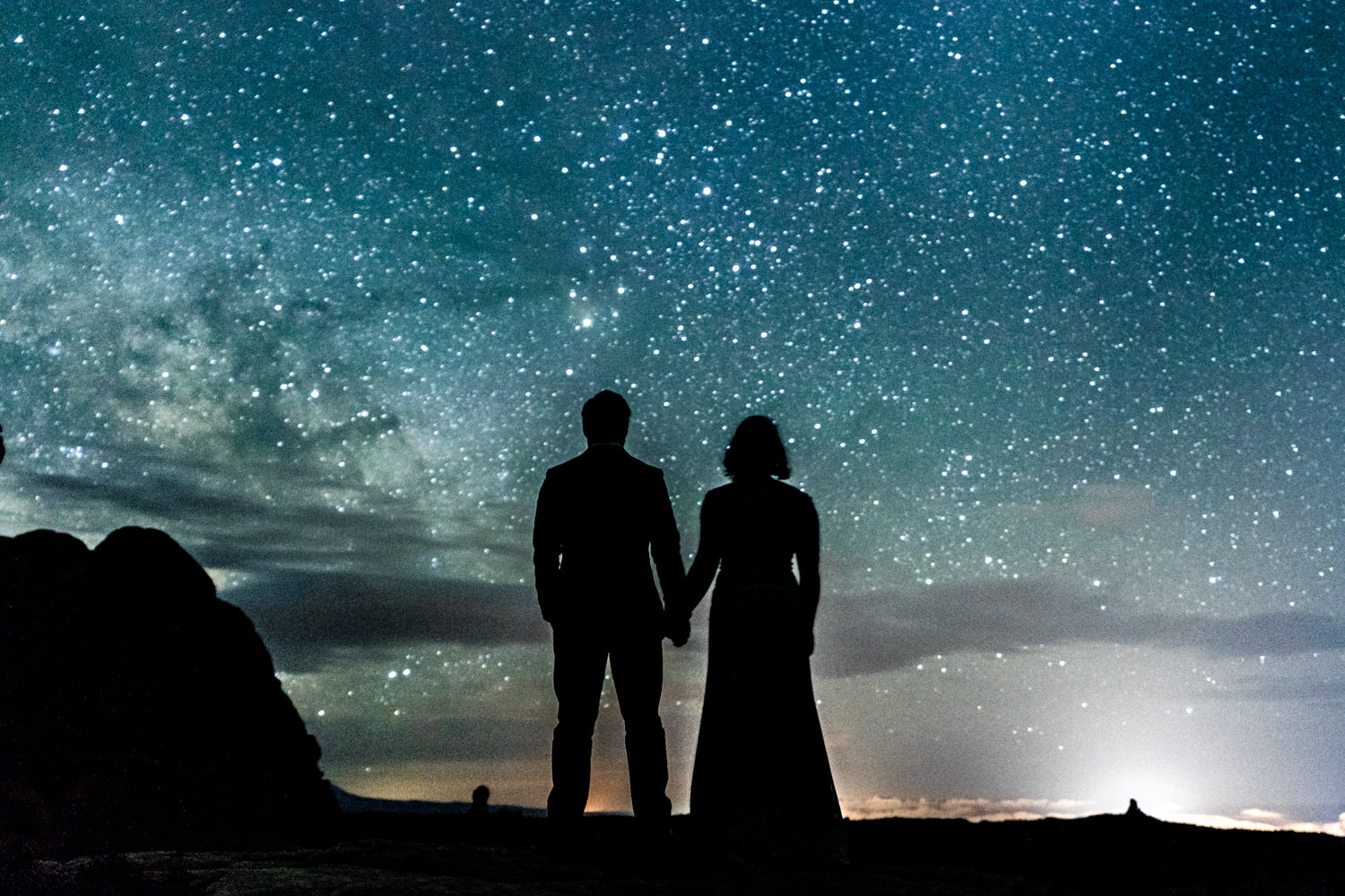 Dead Horse Point elopement silhouette with night sky photo