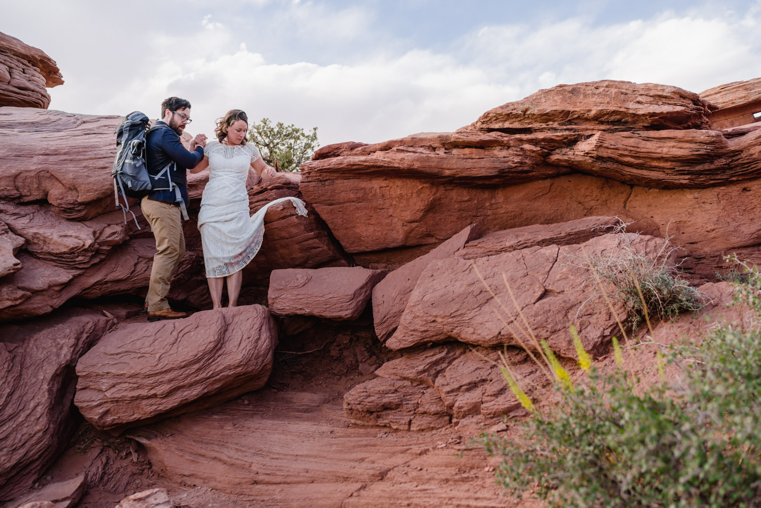 Dead Horse Point elopement climbing over rocks photo