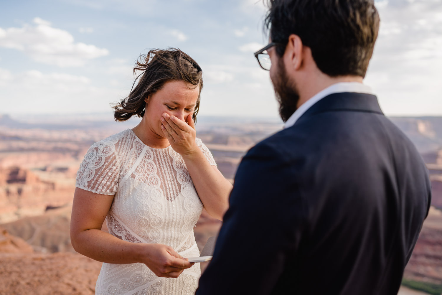 Dead Horse Point elopement bride reading with emotion photo