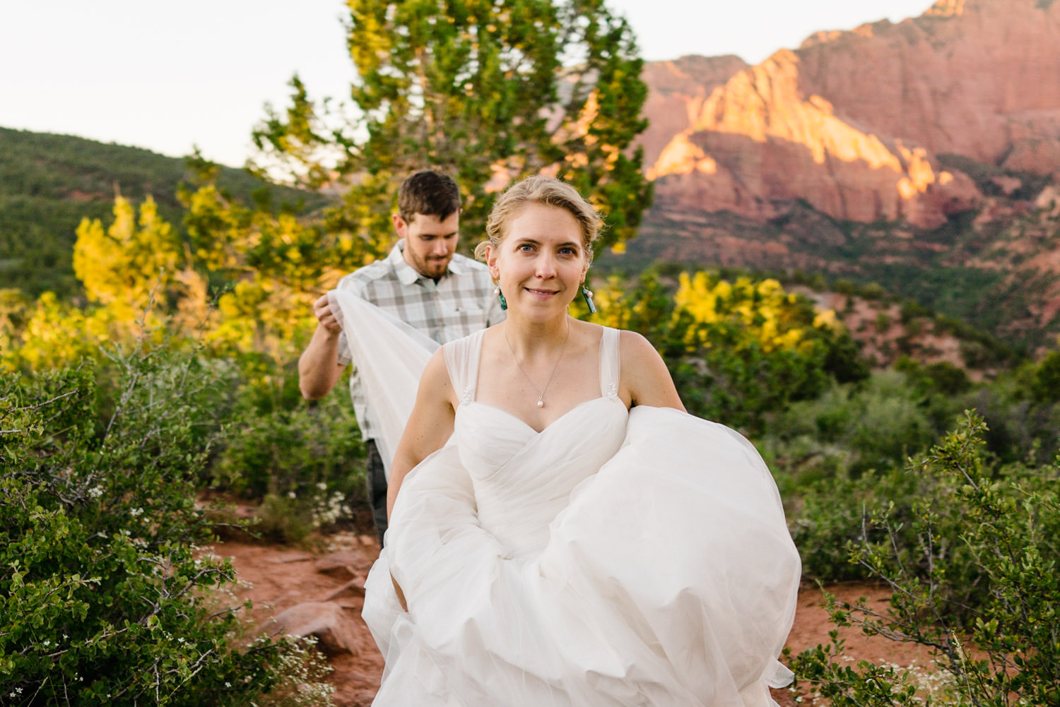 Kolob Canyons Wedding groom holding the bride's train photo