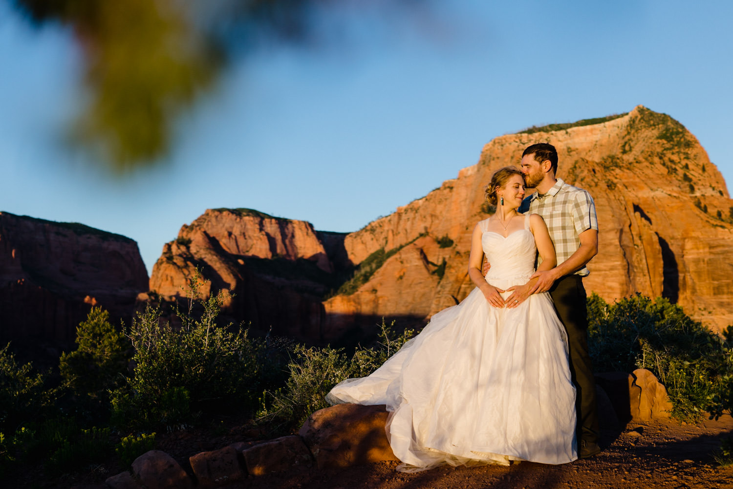 Kolob Canyons Wedding in Zion National Park groom kissing the bride's forehead photo
