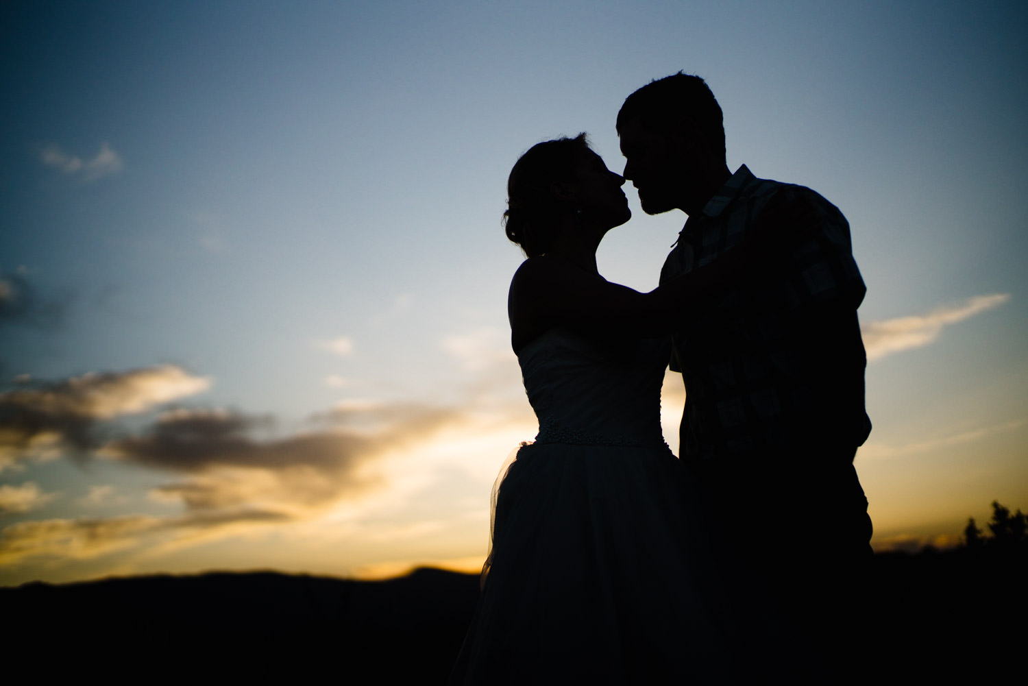 Kolob Canyons Wedding in Zion National Park bride and groom kissing at dusk photo