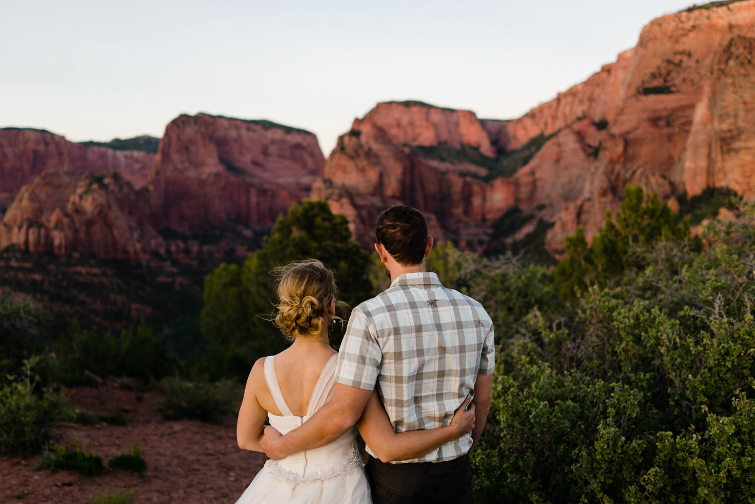 Kolob Canyons Wedding in Zion National Park newlyweds embracing photo