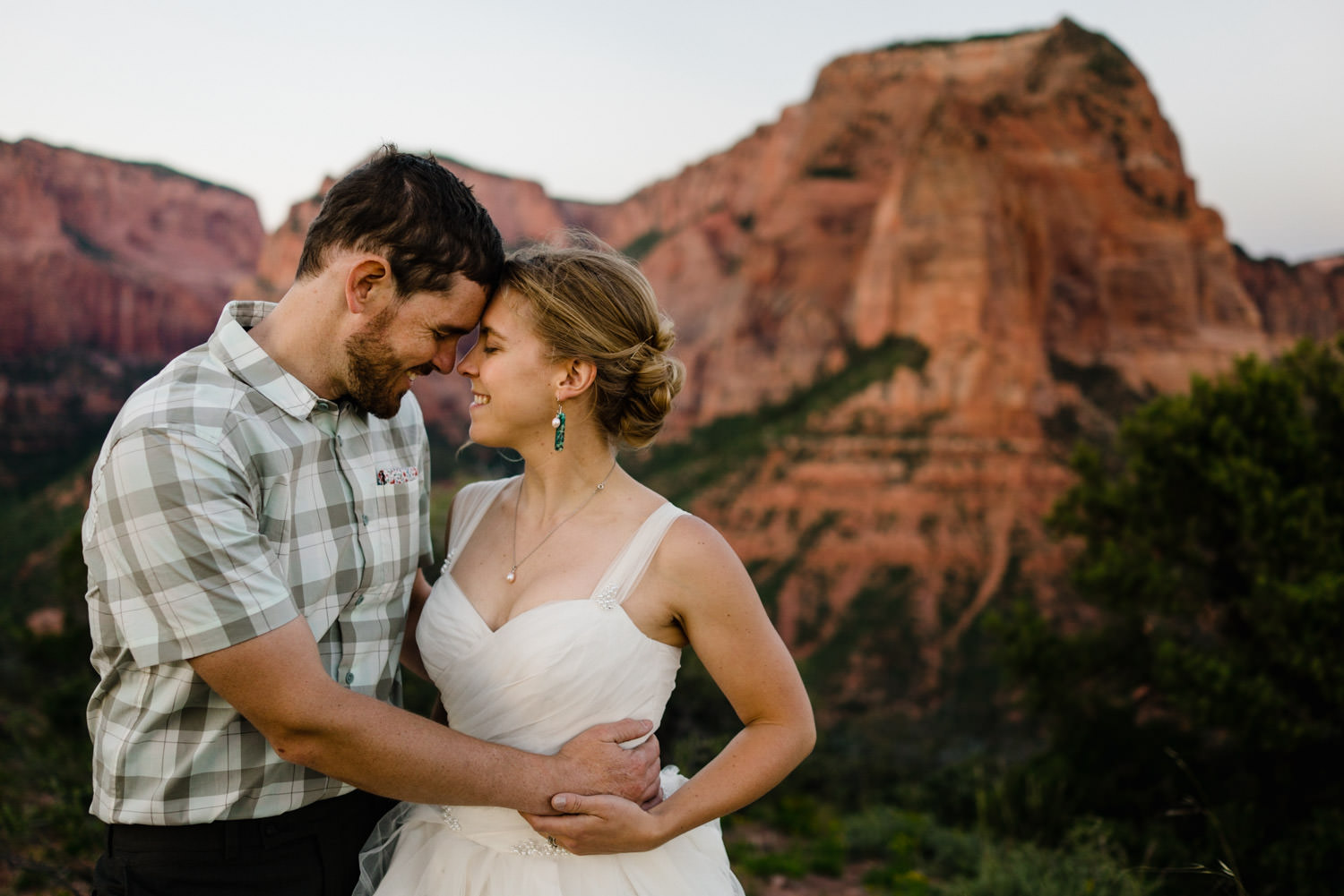 Wedding in Zion National Park bride and groom smiling at each other photo