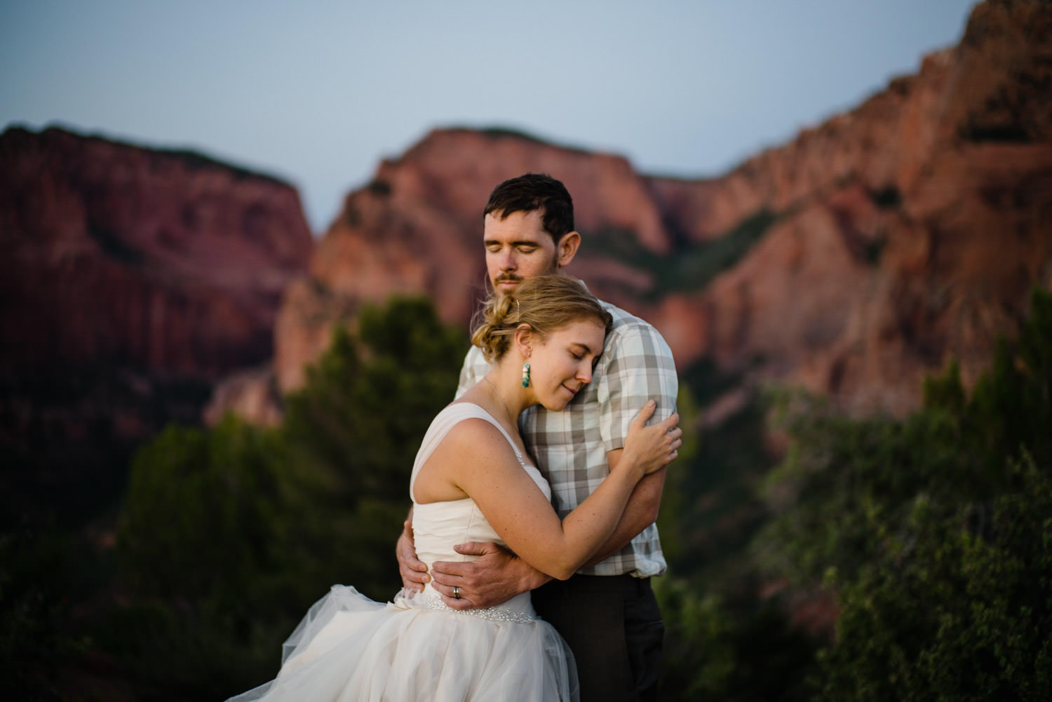 Kolob Canyons Wedding bride and groom hugging photo