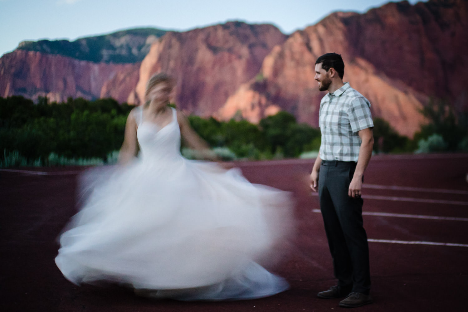 Kolob Canyons Wedding in Zion National Park bride twirling photo