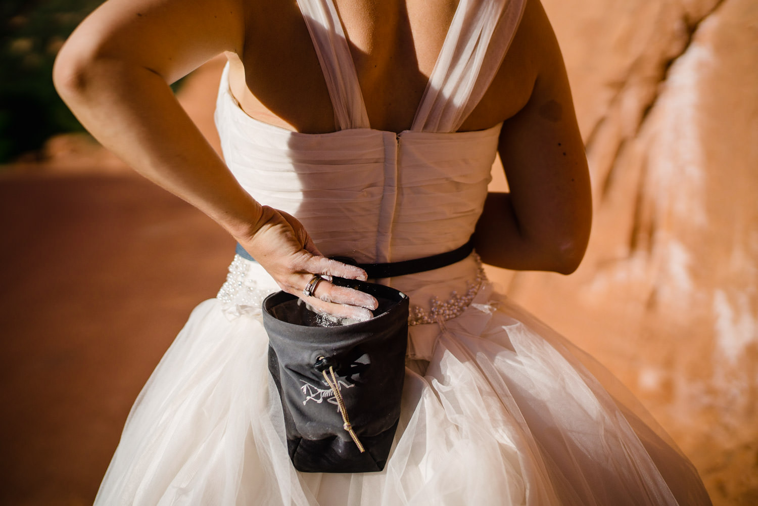 Kolob Canyons Wedding bride with climbing chalk photo
