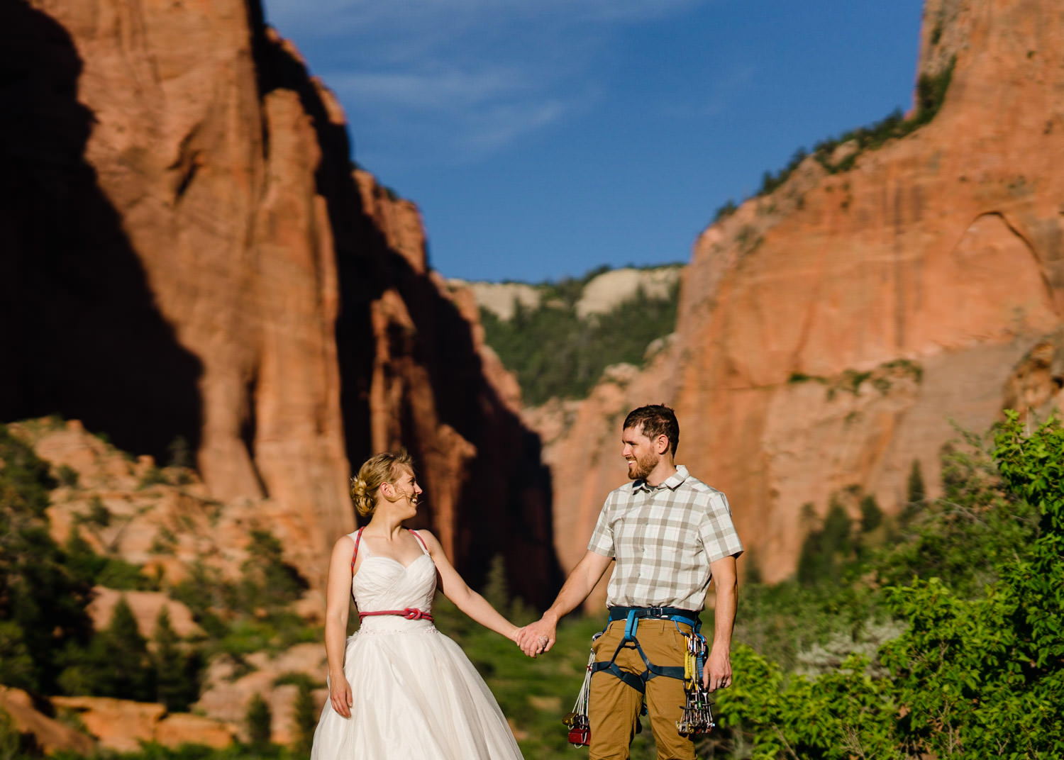 Zion National Park Wedding bride and groom holding hands photo