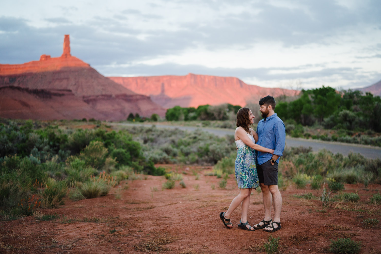 engagement session in Moab with Castleton Tower in background photo