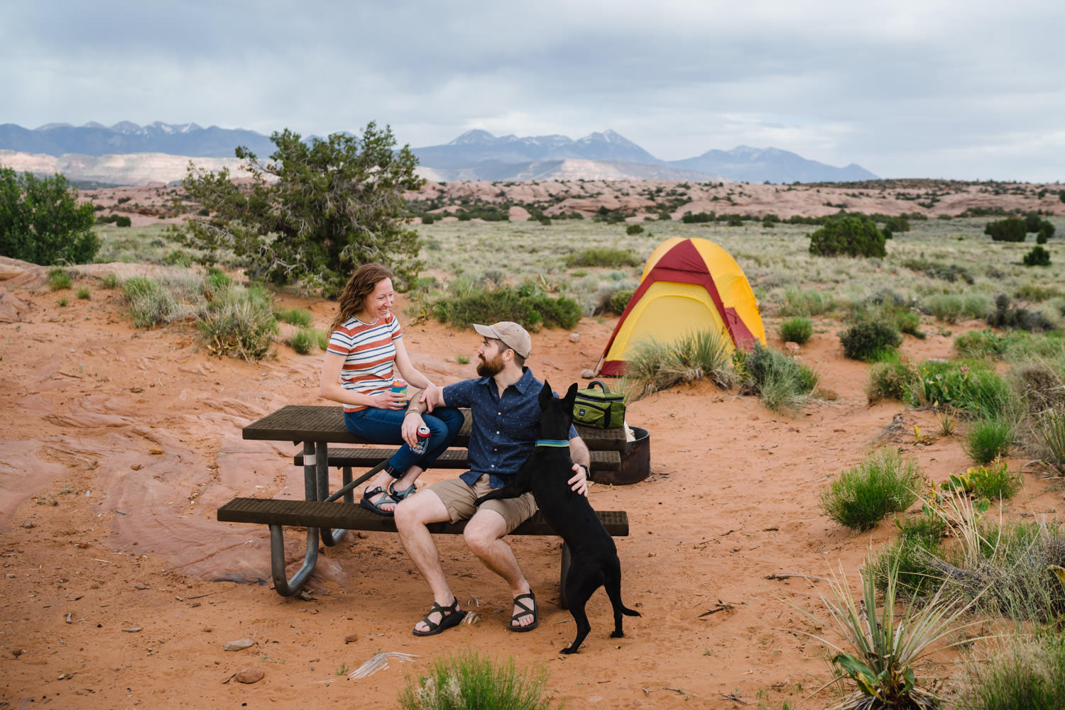 engagement session in Moab Sand Flats camping with dog photo