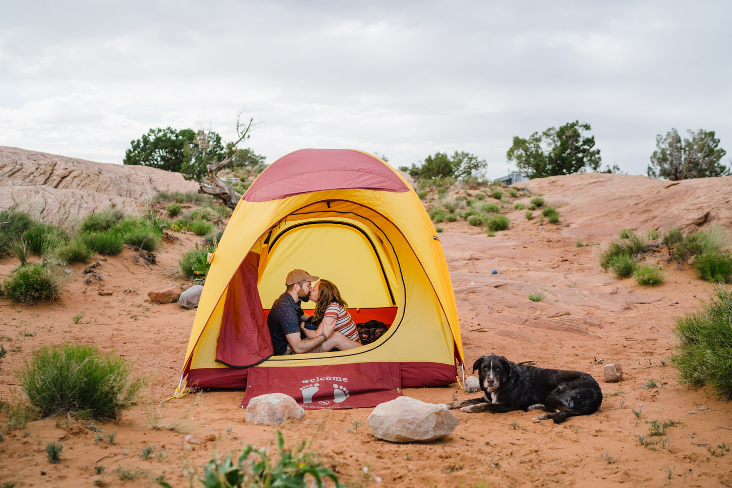 engagement session in Moab kissing in tent Sand Flats photo