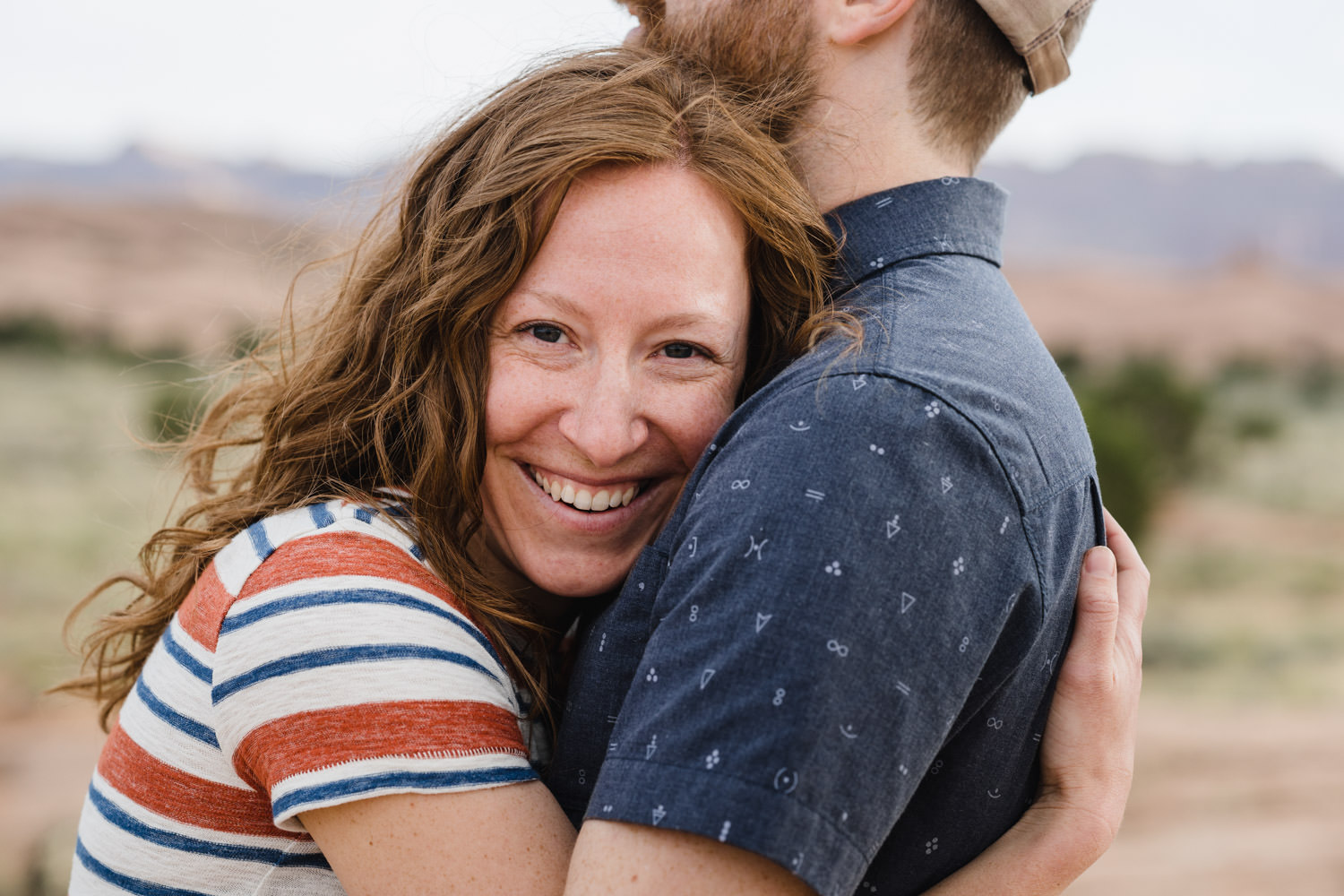 engagement session in Moab smiling while hugging photo