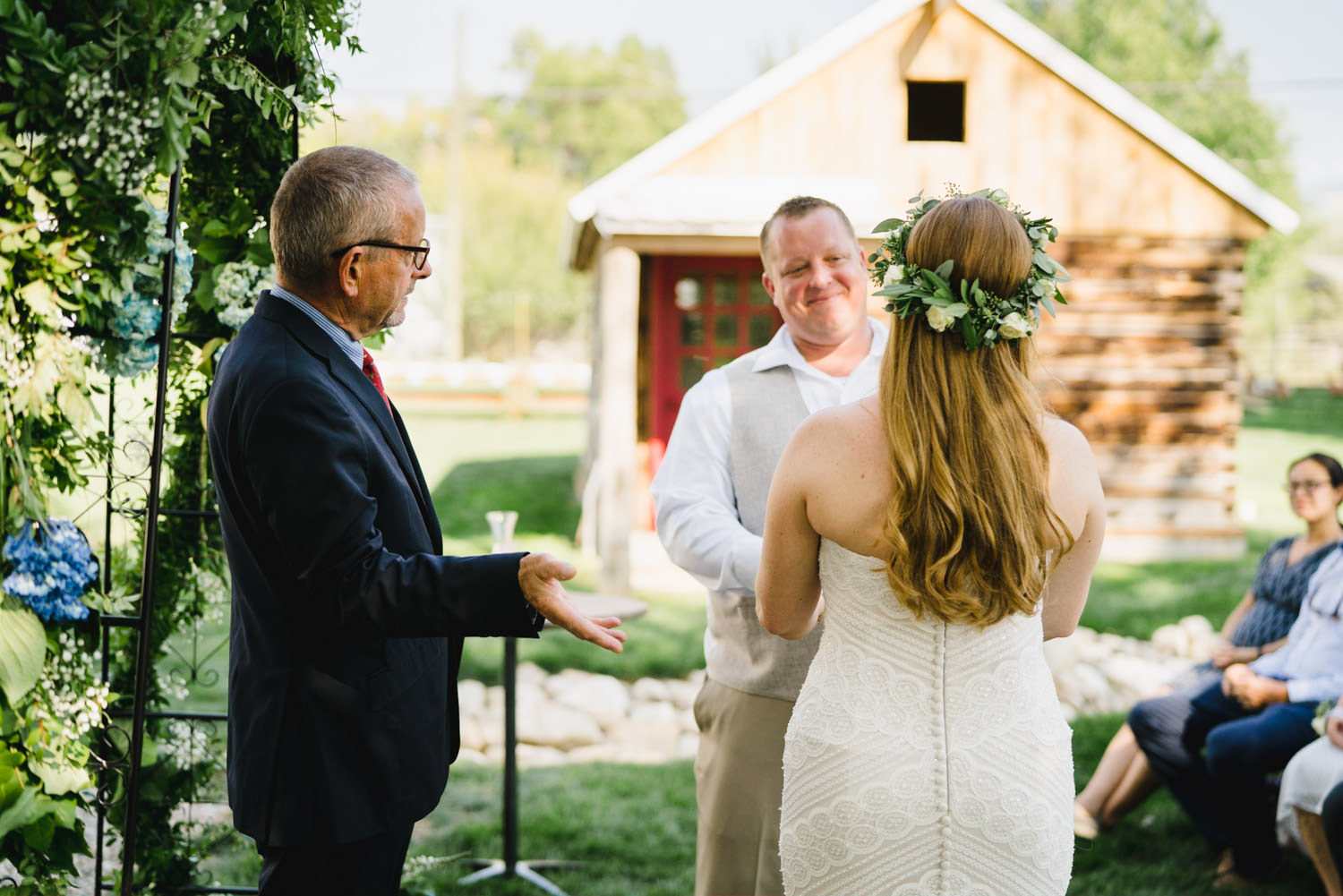 Spring Farm wedding bride, groom and officiant photo