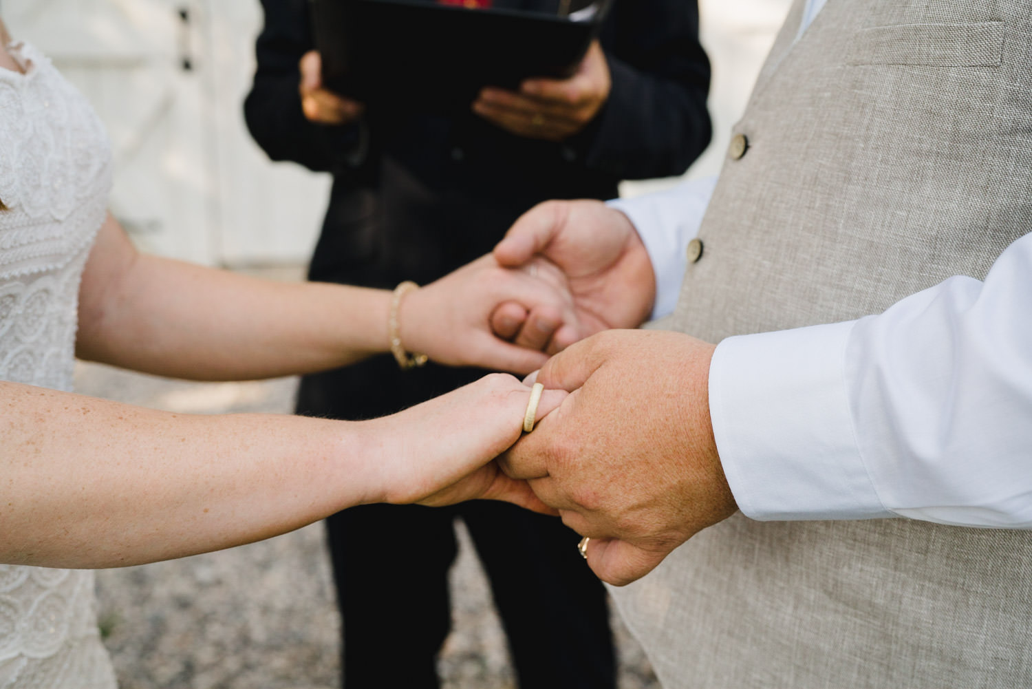 Spring Farm wedding bride and groom holding hands photo