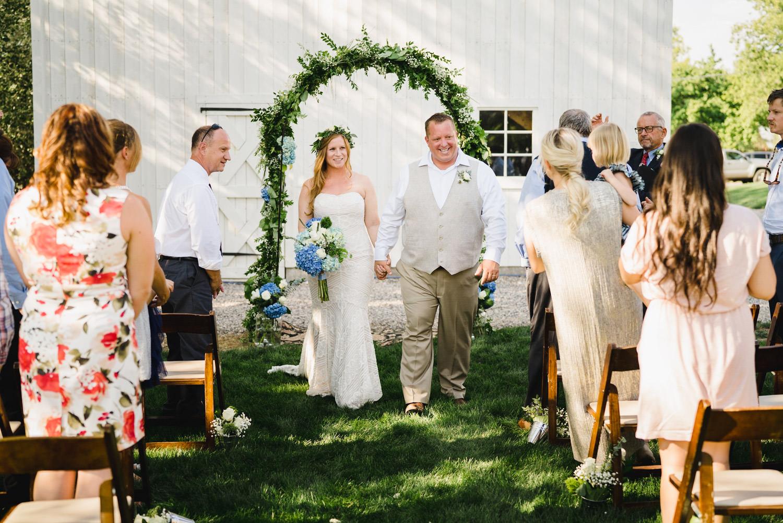 Spring Farm wedding bride and groom leaving ceremony photo