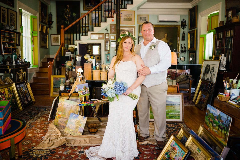 Spring Farm wedding bride and groom in artist studio photo