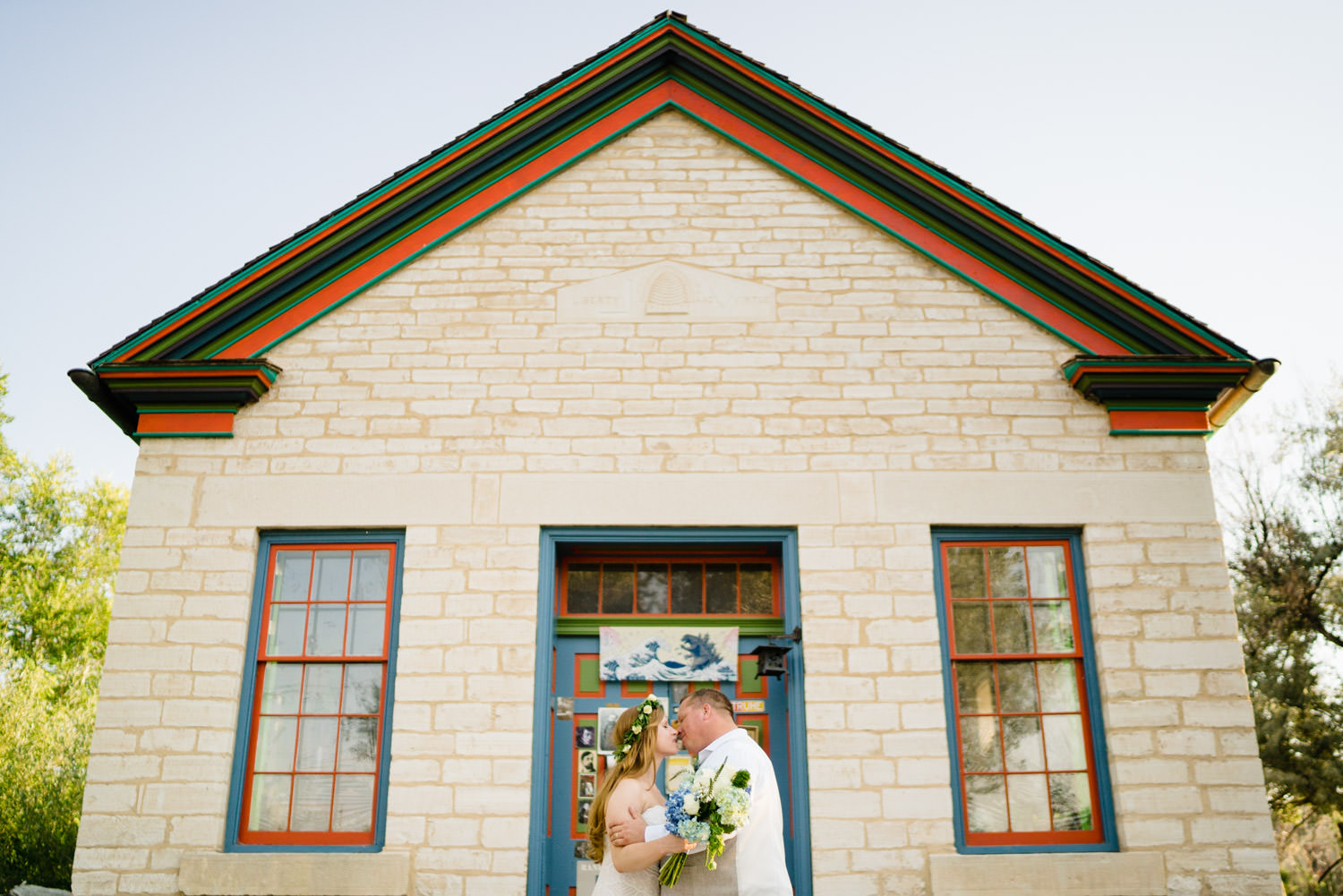 Spring Farm wedding portrait in front of historical building in Spring City photo