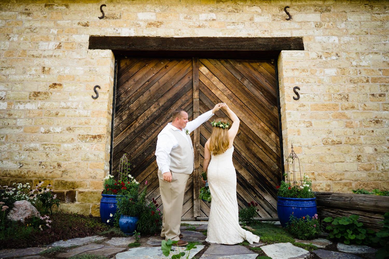 Spring Farm wedding groom twirling bride photo