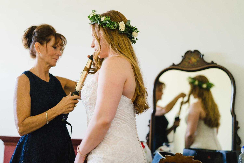 Spring Farm wedding bride getting hair done photo