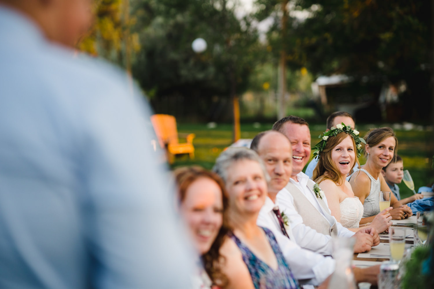 Spring Farm wedding guests smiling at reception photo