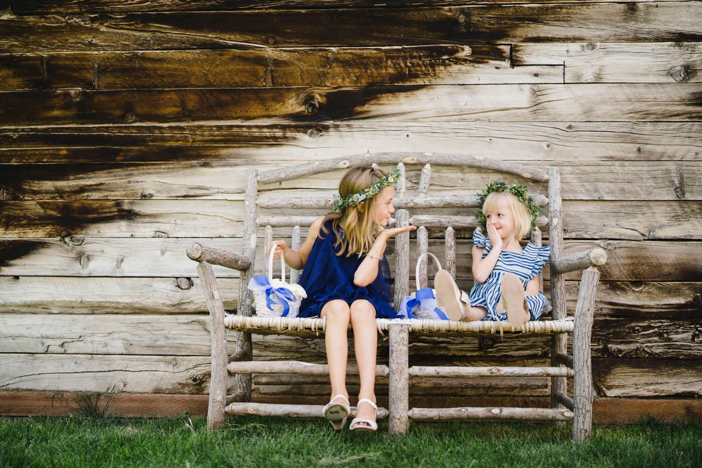 Spring Farm wedding flower girls on bench photo