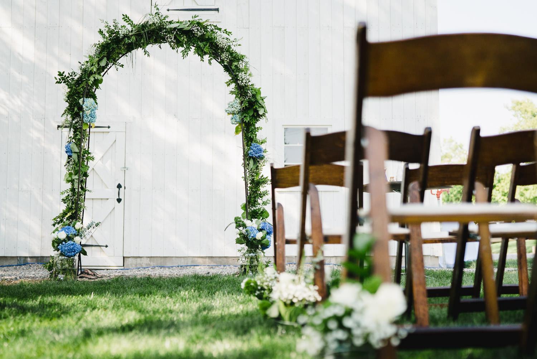 Spring Farm wedding green ceremony arch photo