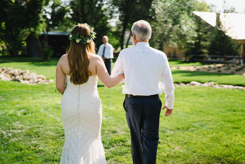 Spring Farm wedding bride walking down aisle photo