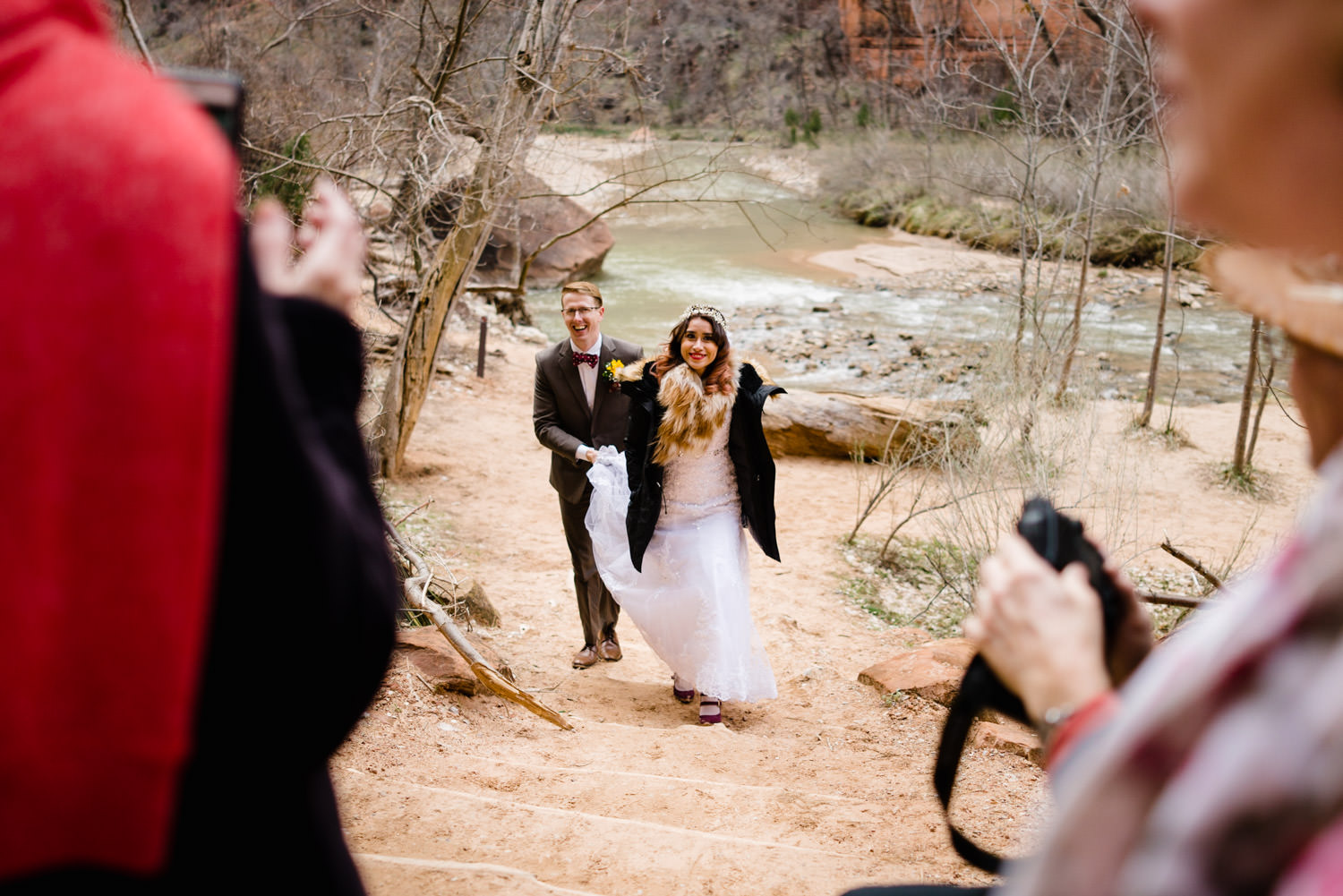 Temple of Sinawava wedding bride and groom walking from the Virgin River photo