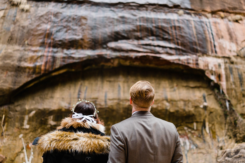 Temple of Sinawava wedding couple admiring the rocks photo