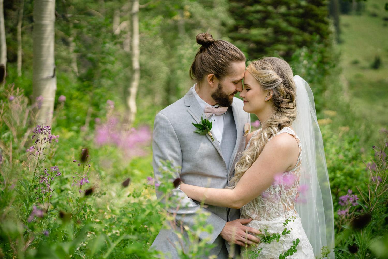 happy couple outside in trees alta resort wedding
