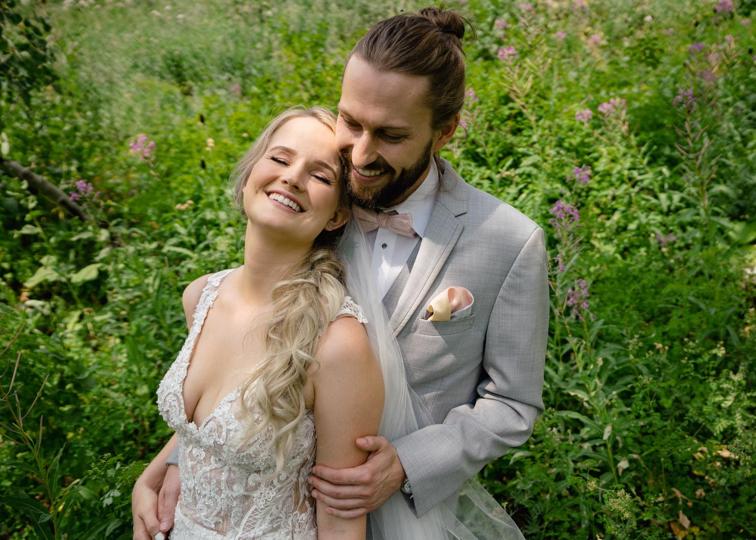 joyful bride and groom in wild flowers alta lodge