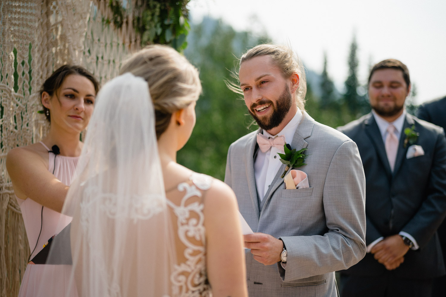 groom reading vows to bride outside alta lodge