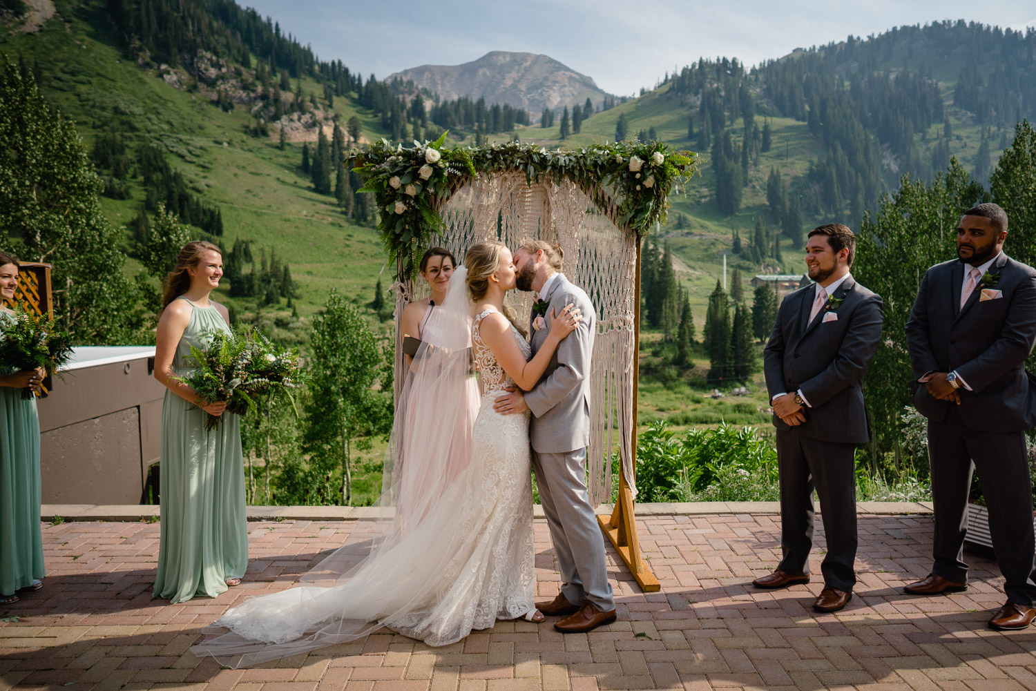 bride and groom first kiss outdoor altar mountain wedding alta resort