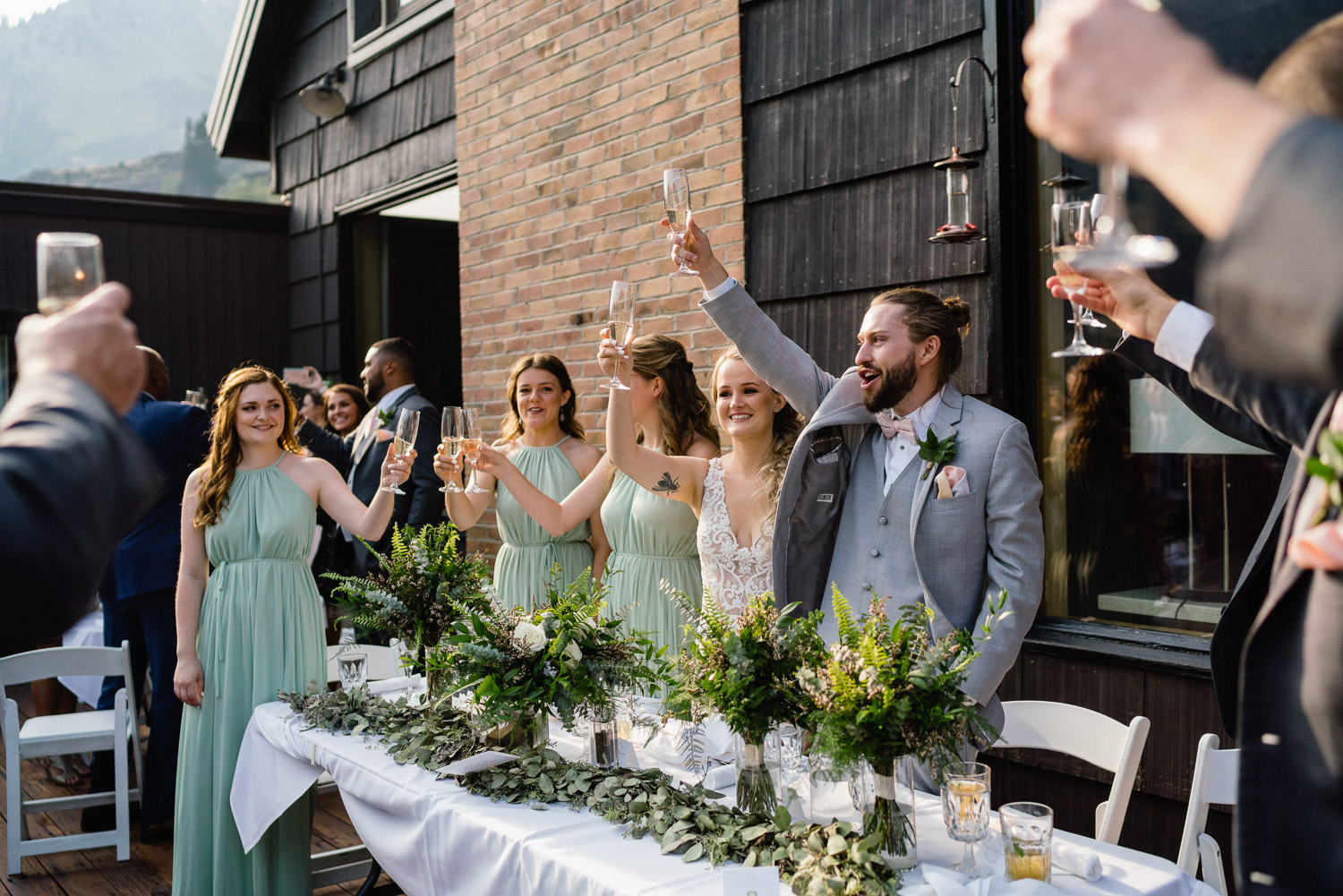 wedding party cheers on alta lodge deck