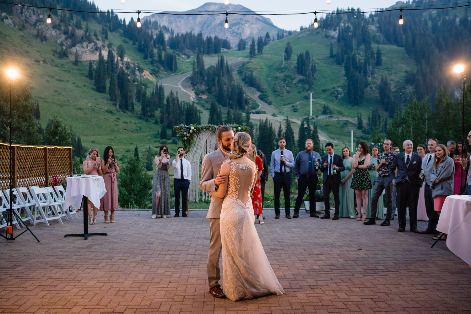 bride and groom first dance outside mountain scene alta