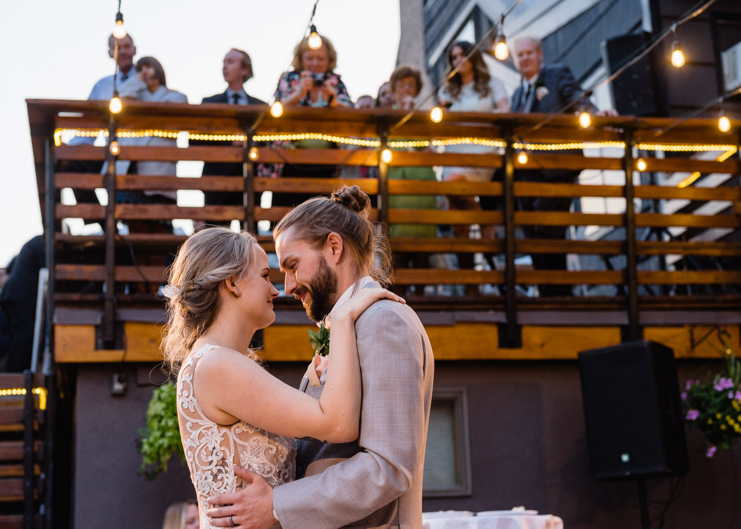 guests watch bride and groom dancing from deck alta lodge