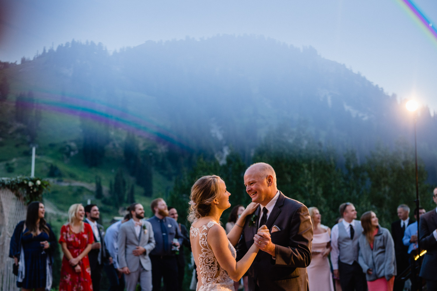 bride dancing with father at dusk alta lodge
