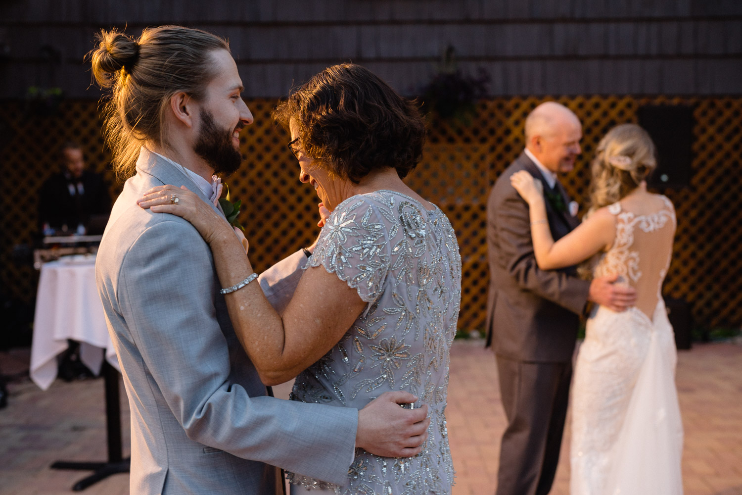 groom dancing with mother outside alta