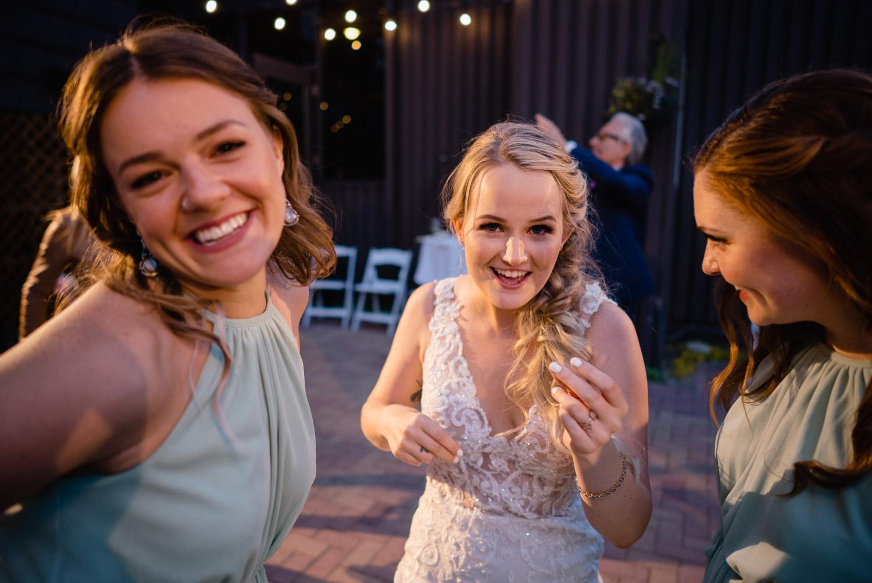 bride and bridesmaids dancing at reception alta