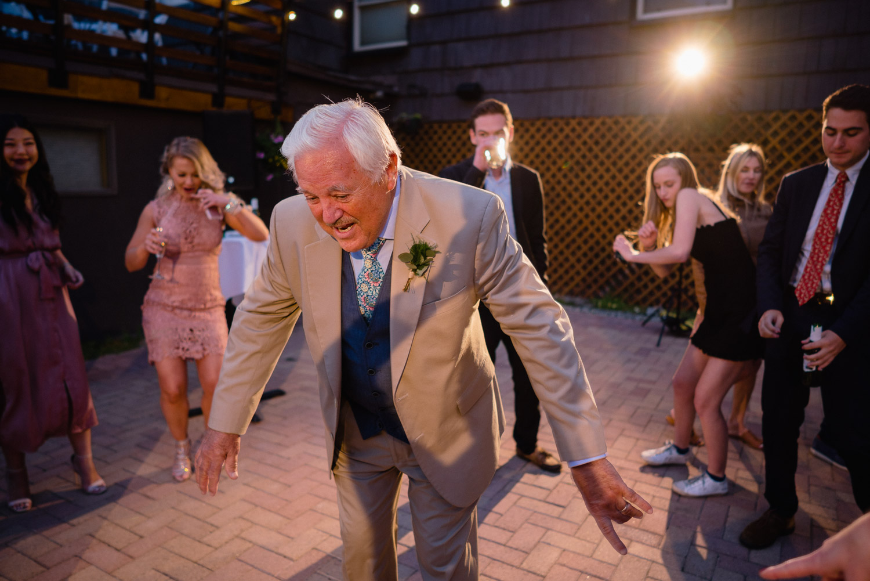 grandpa dancing at outdoor night reception alta lodge