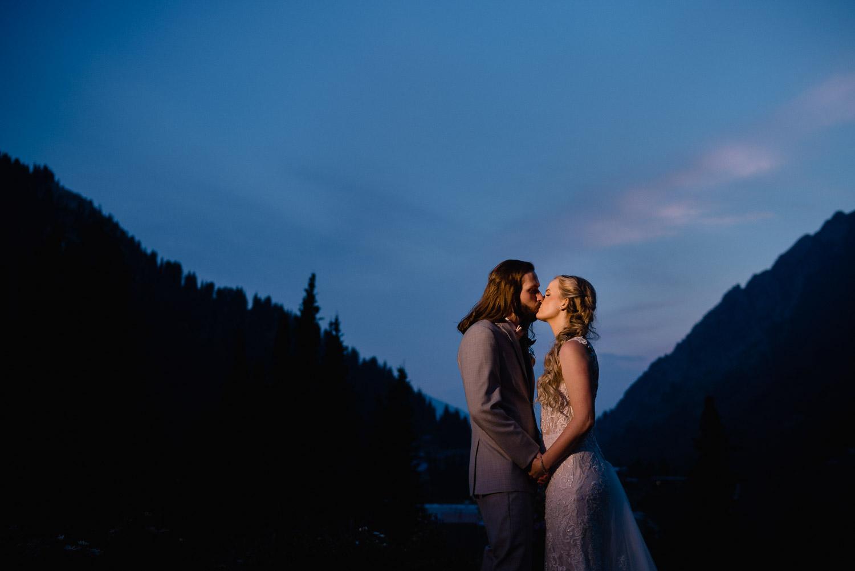 couple kissing under night sky alta wedding